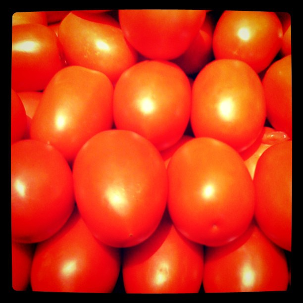 Tomatoes Stacked in Produce Section of Supermarket